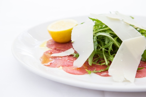 Carpaccio Di Manzo thinly sliced beef, rocket, topped with parmesan & lemon gf £7 (1)