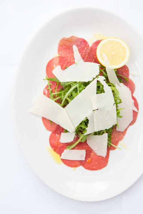 Carpaccio Di Manzo thinly sliced beef, rocket, topped with parmesan & lemon gf £7 (2)