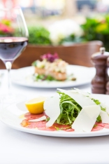Carpaccio Di Manzo thinly sliced beef, rocket, topped with parmesan & lemon gf £7 (3)