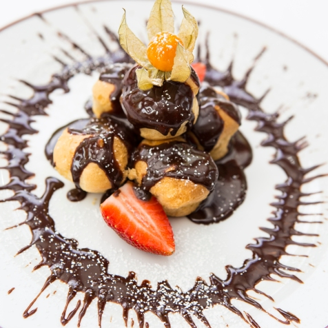 Profiteroles choux pastry cases filed with Chantilly cream, served with chocolate sauce £5 (1)