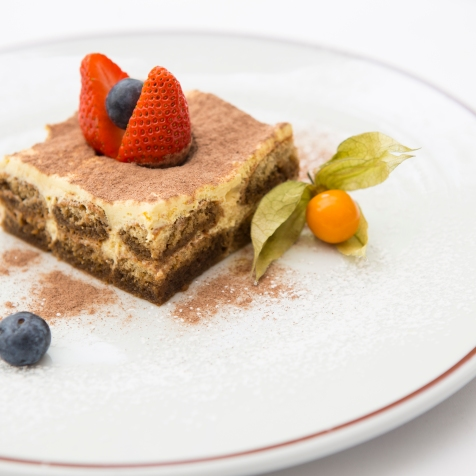 Tiramisu - Savoiardi biscuits lightly soaked in a coffee punch, with mascarpone cheese and amaretto liqueur £5.5 (1)